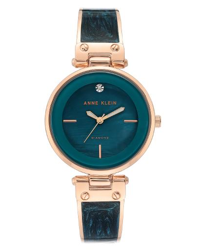 Anne Klein Women's Trend Teal mother of pearl Dial Nickel compliant rose gold with teal marble enamel Metal Watch. AK2512TERG